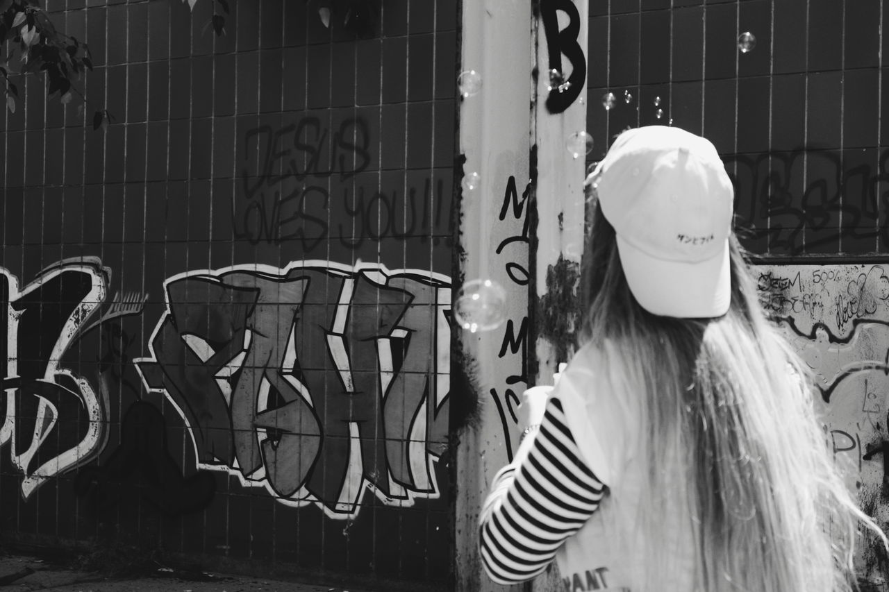 Real People Outdoors Day Only Women One Person People One Young Woman Only Blackandwhite Black And White Architecture Young Women Destroyed Building Adult Young Adult Standing Lifestyles Summer Happiness Summer Happiness Freedoom  Dance Bubbles Blowing Bubbles Baseball Cap Cap