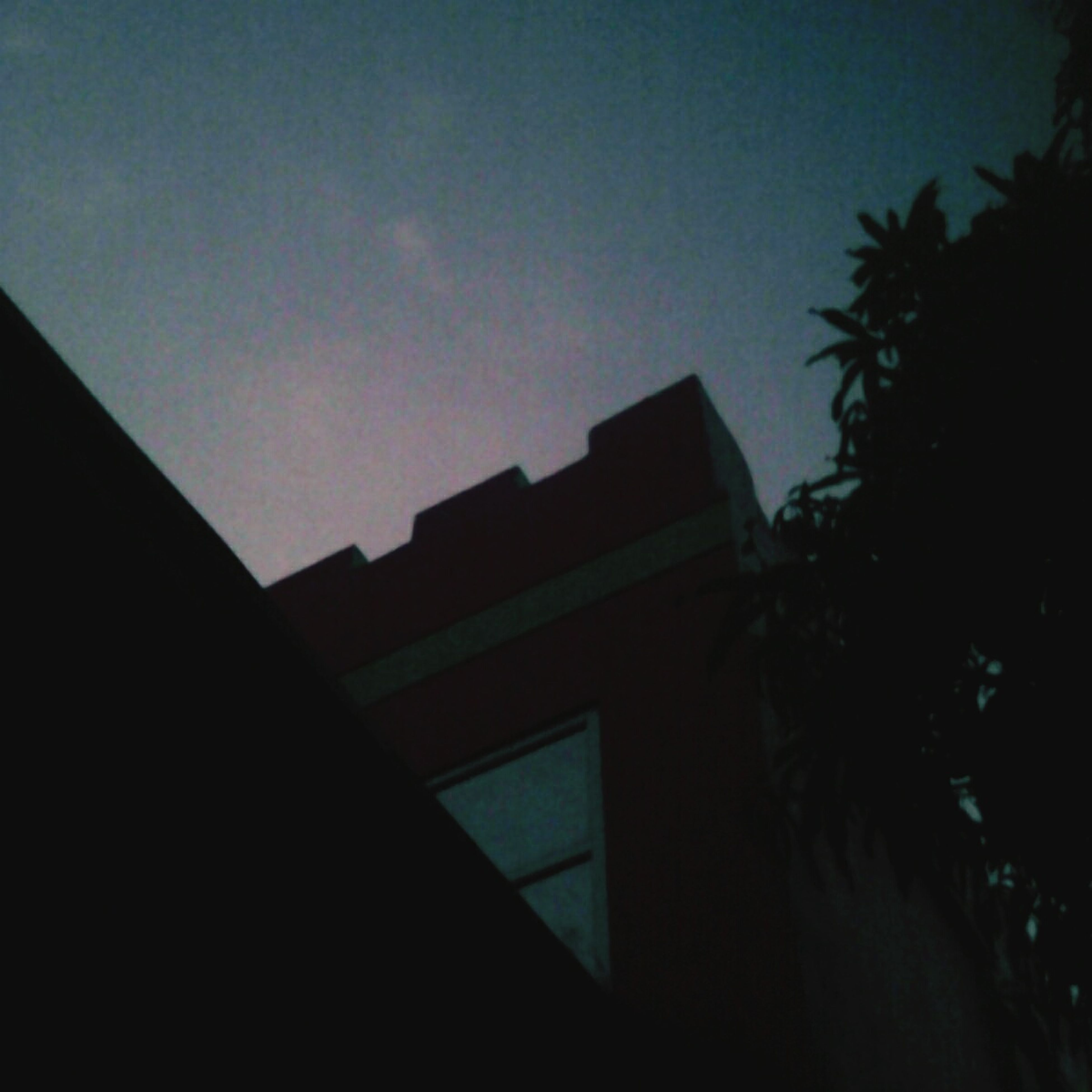 architecture, building exterior, built structure, low angle view, clear sky, residential structure, residential building, house, window, sky, tree, building, silhouette, copy space, no people, outdoors, high section, city, dusk, day