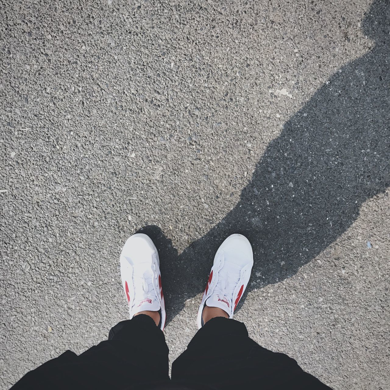 shoe, real people, human leg, low section, one person, standing, high angle view, shadow, personal perspective, men, human body part, lifestyles, day, sunlight, outdoors, people