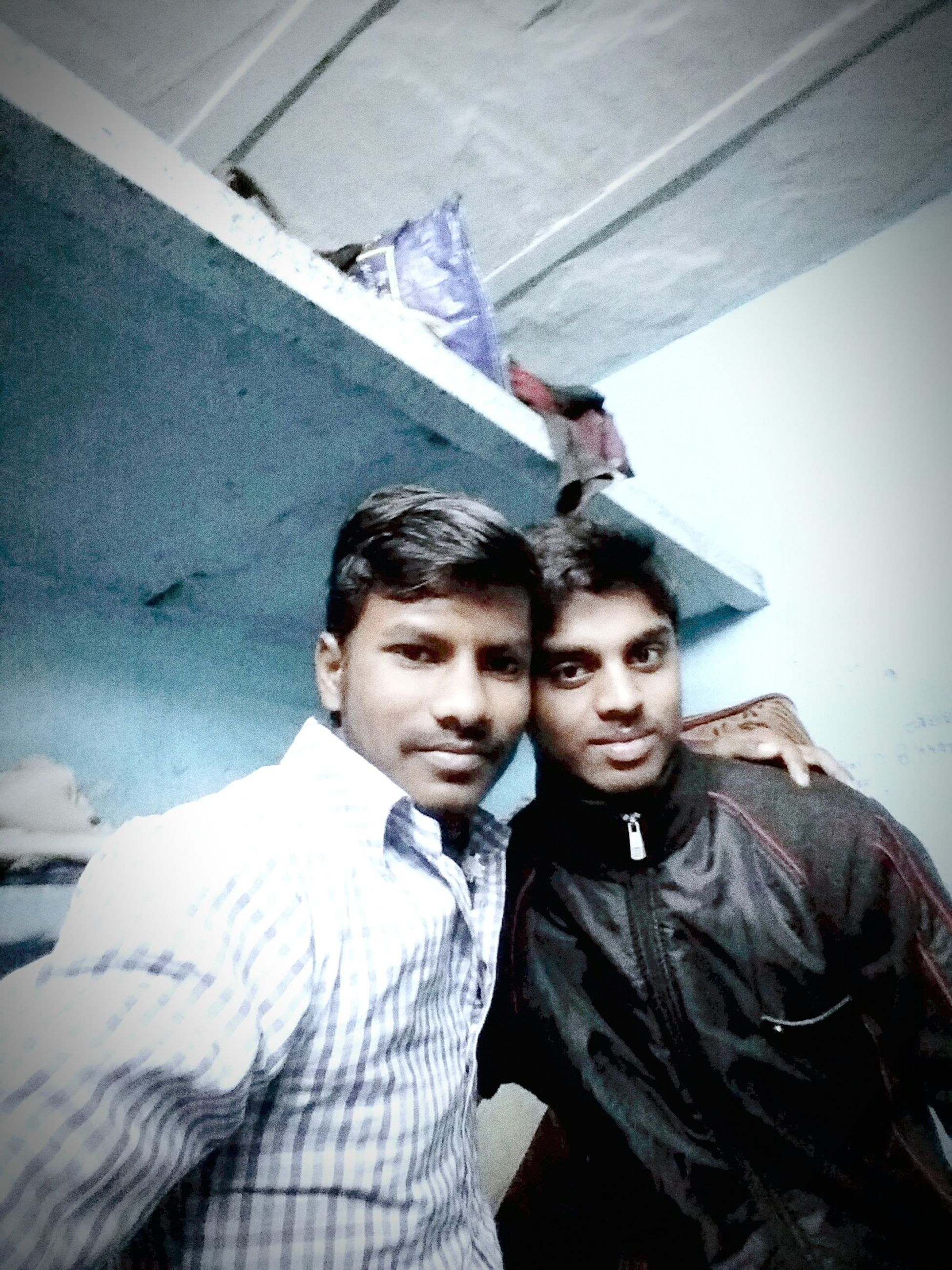 two people, front view, togetherness, portrait, bonding, real people, young adult, men, indoors, friendship, sky, day, adults only, people, adult