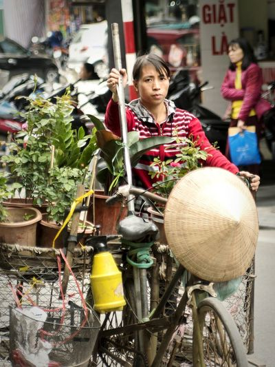 Peddlers of Vietnam Vietnam Streetphotography Vietnamphotography Vietnam People Outdoors One Person Building Exterior Business Finance And Industry