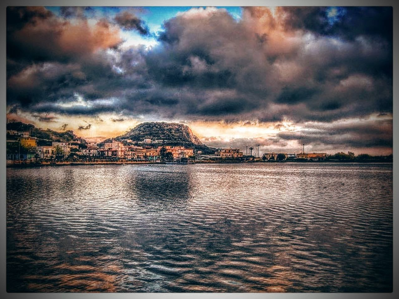 cloud - sky, auto post production filter, sky, water, scenics, dramatic sky, no people, nature, building exterior, tranquility, outdoors, beauty in nature, architecture, sunset, built structure, tranquil scene, rippled, storm cloud, lake, day
