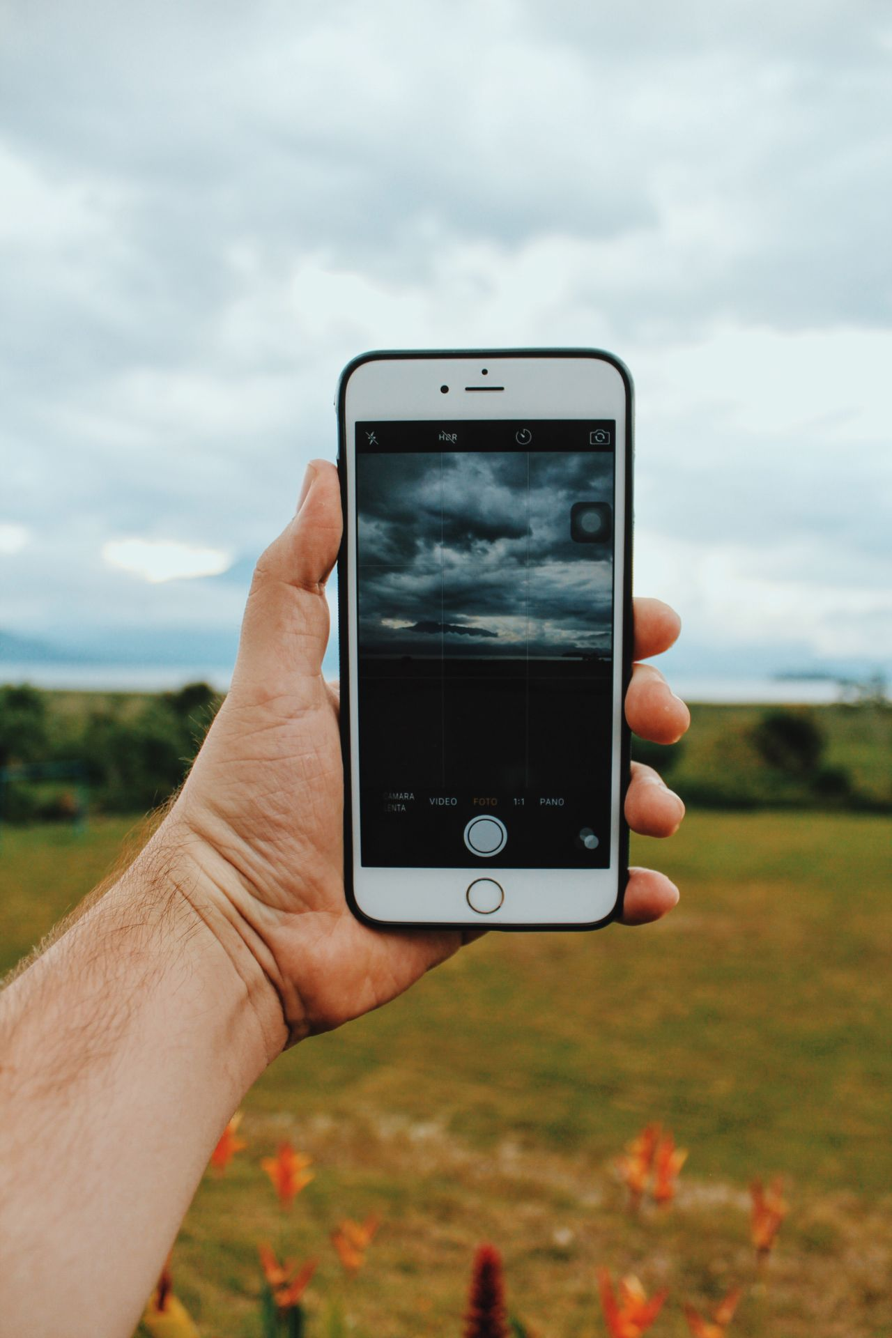 Home Human Hand Communication Holding Smart Phone Honduras EyeEm Best Shots Moodygrams Expofilm EyeEm Mood Portable Information Device Technology Human Body Part Cloud - Sky Real People One Person Leisure Activity Day Connection Close-up Landscape Grass Screen Sky