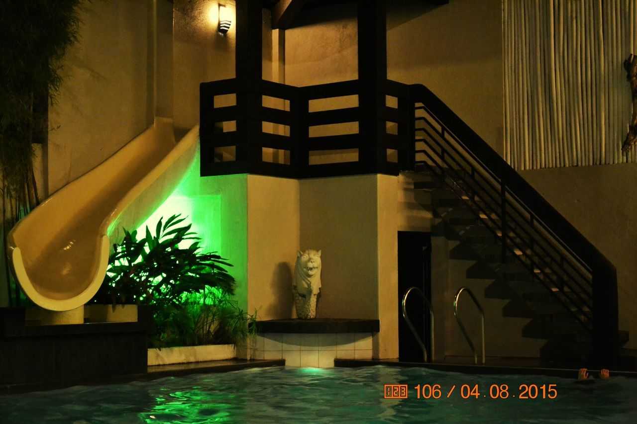 swimming pool, indoors, illuminated, architecture, water, no people, luxury, tree, home showcase interior, day