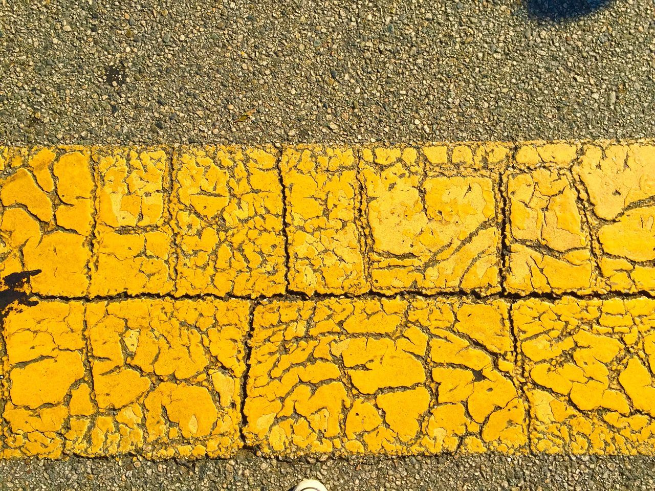 Close-Up Of Yellow Pattern On Road