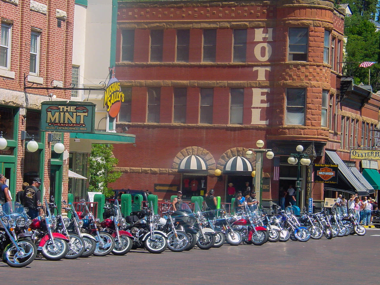 Abundance Architecture Bicycle Building Exterior Built Structure City City Life Collection Crowd Day Deadwood  Land Vehicle Large Group Of People Mode Of Transport Motor Scooter Motorcycle Outdoors Parked Parking Person Retail  Roadside Stationary Sturgis Transportation