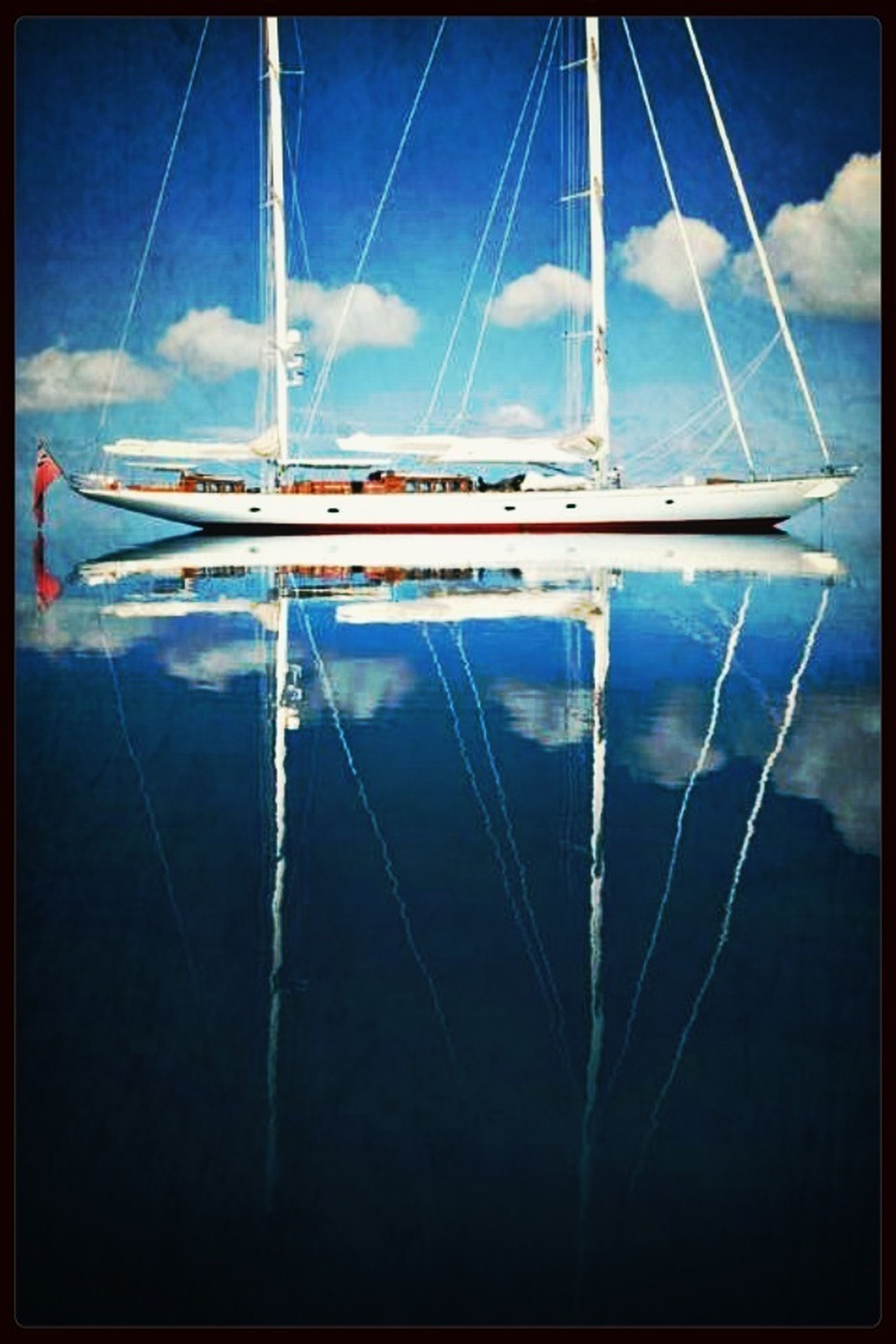 transportation, mode of transport, nautical vessel, transfer print, boat, moored, sky, mast, auto post production filter, water, sailboat, travel, cloud - sky, harbor, day, cloud, reflection, no people, outdoors, sea