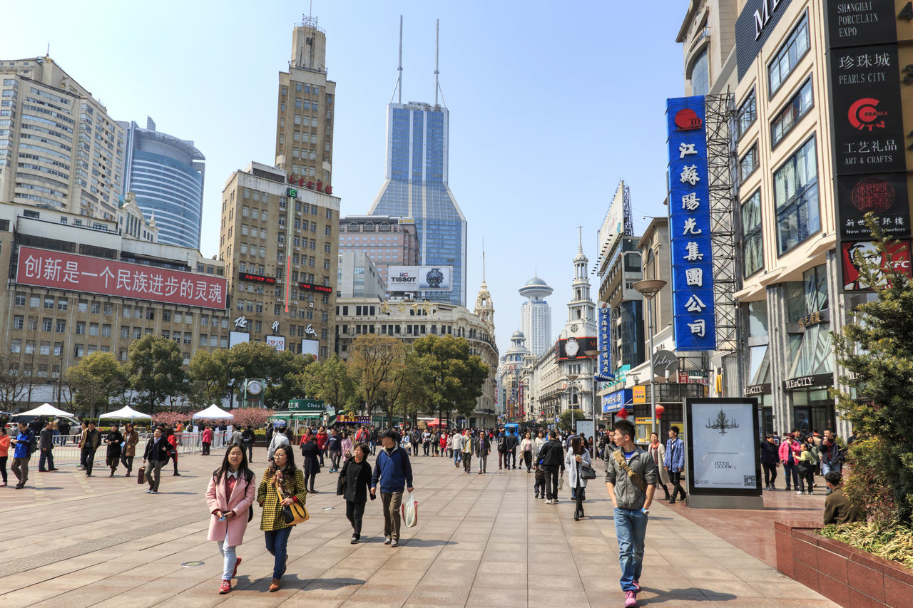 Shanghai, China - March 26, 2016: Tourists walking in Nanjing Road, one of the world's busiest shopping streets. Architecture Beijing Building Exterior Built Structure China Chinese City City Life City Street Futures Building Jin Mao Tower Large Group Of People Nanjing Road One Lujiazui Oriental Pearl People Plaza 66 Shanghai Shanghai Tower Shimao International Plaza Skyscraper Tomorrow Square Tourists Wheelock Place World Financial Center