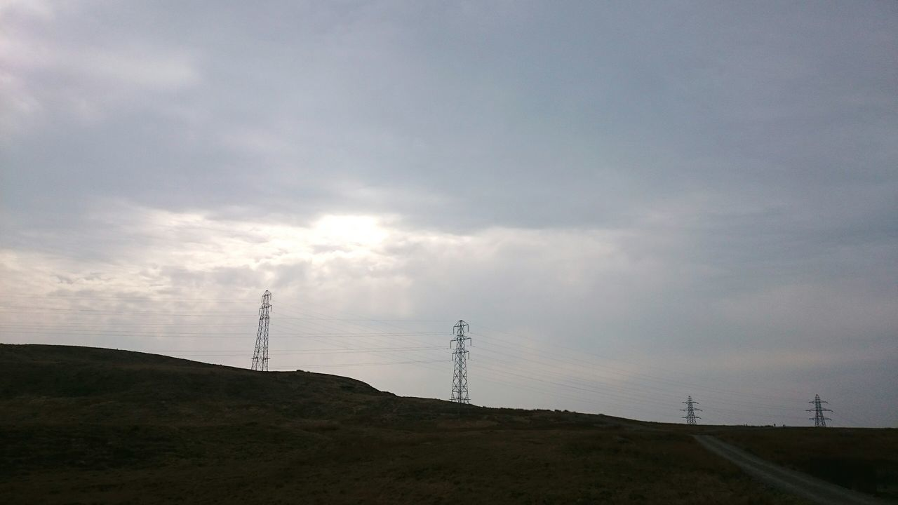 4 Electric Tower  Walking In The Hills Sky And Clouds In The Distance