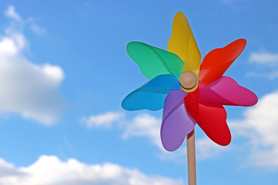 Colorful pin wheel. White clouds. Pin Wheel Color Colorful Blue Sky Multi Colored No People Close-up Cloud - Sky Summer Day Nature Outdoors Childhood Sunshine Clear Summer Spring Springtime Playful Cheerful Joy Happiness Freedom wind. Motion. Copy space