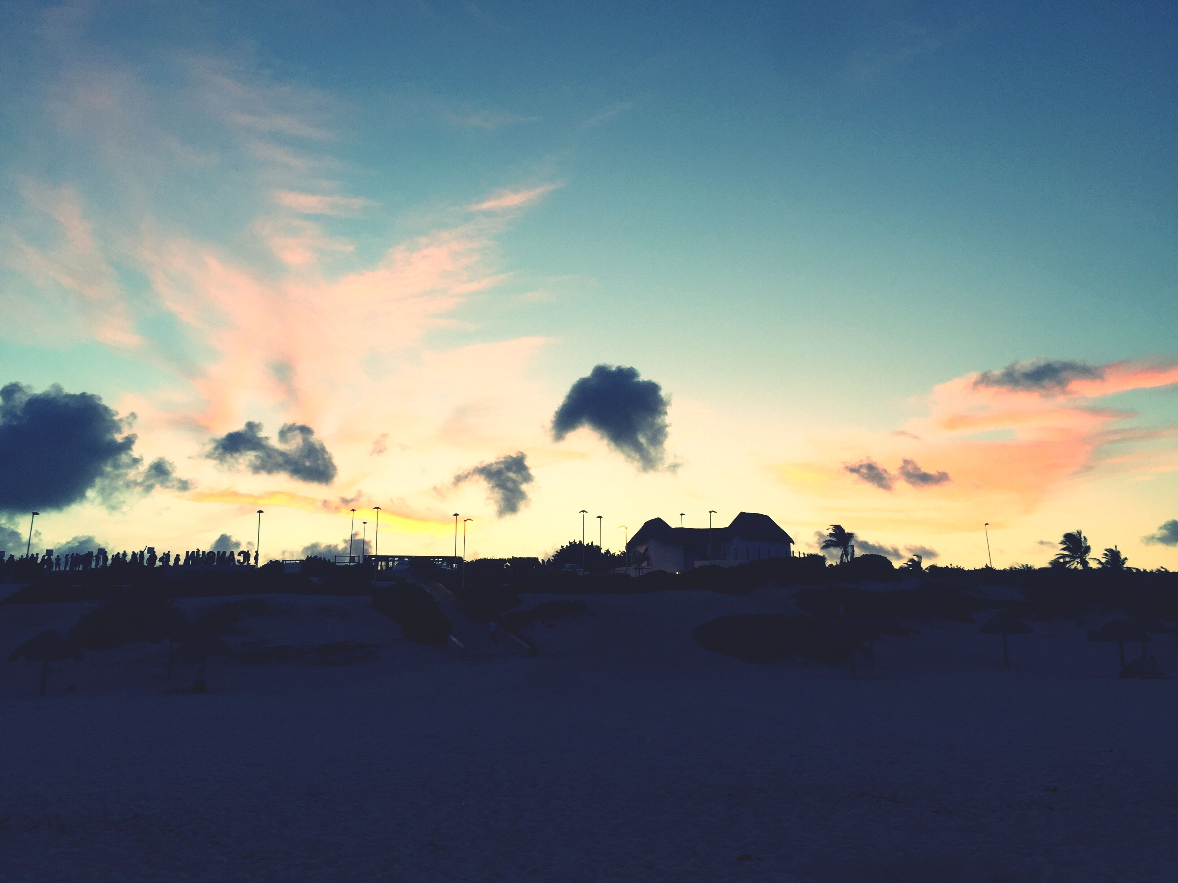 house, sunset, silhouette, sky, landscape, built structure, architecture, tranquil scene, scenics, building exterior, dusk, tranquility, cloud - sky, beauty in nature, dark, cloud, nature, outdoors, town, calm, non-urban scene, no people, remote, majestic, cloudy