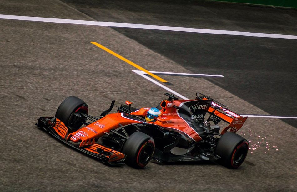 Fernando Alonso creates sparks with his McLaren at the Chinese Grand Prix Sports Race Motorsport Auto Racing Racecar Outdoors Day Sport F1 Grandprix Formula 1 Fernando Alonso China Shanghai Chinese Grand Prix