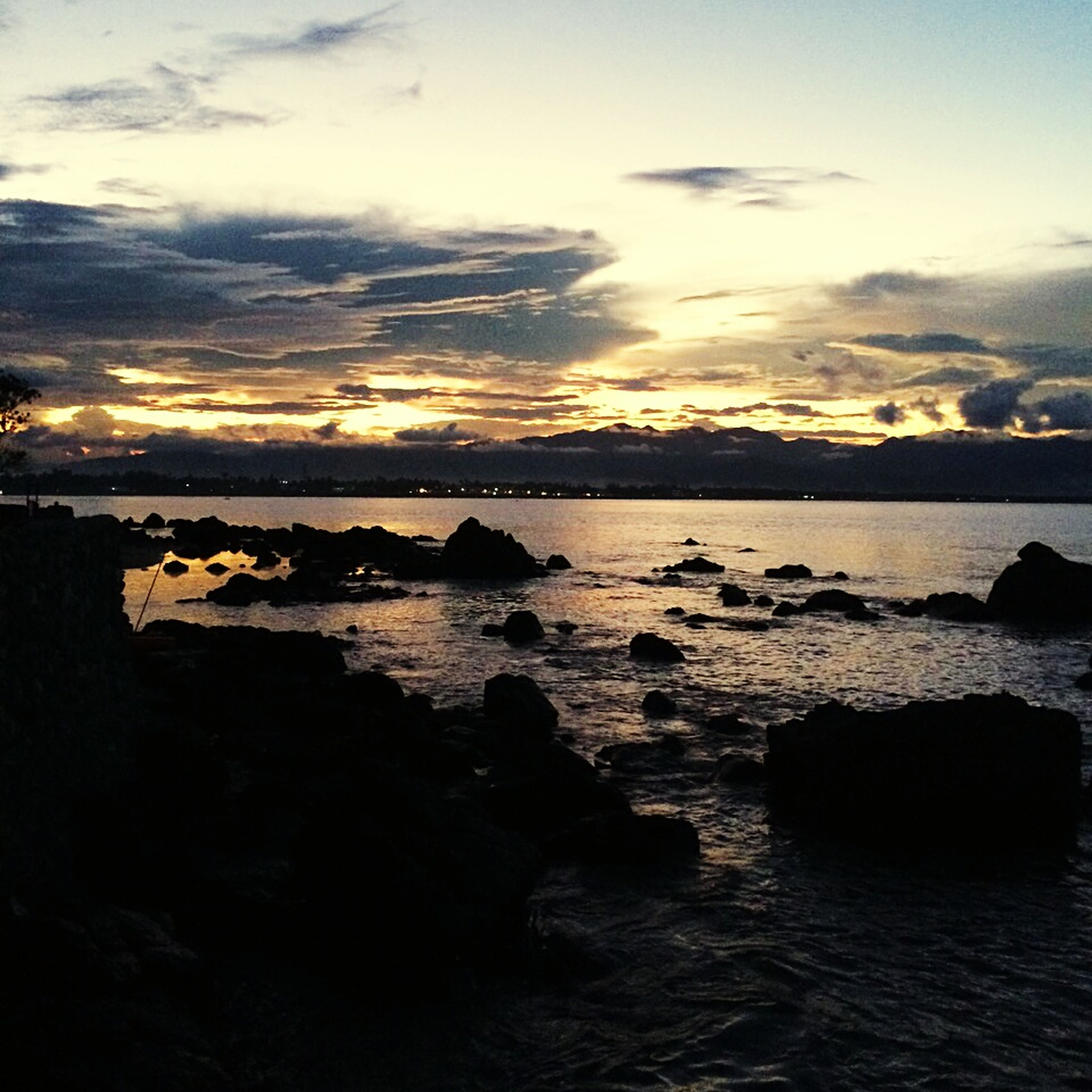 water, sunset, sky, tranquil scene, scenics, sea, tranquility, beauty in nature, cloud - sky, nature, idyllic, silhouette, cloud, rock - object, waterfront, reflection, rippled, cloudy, outdoors, calm