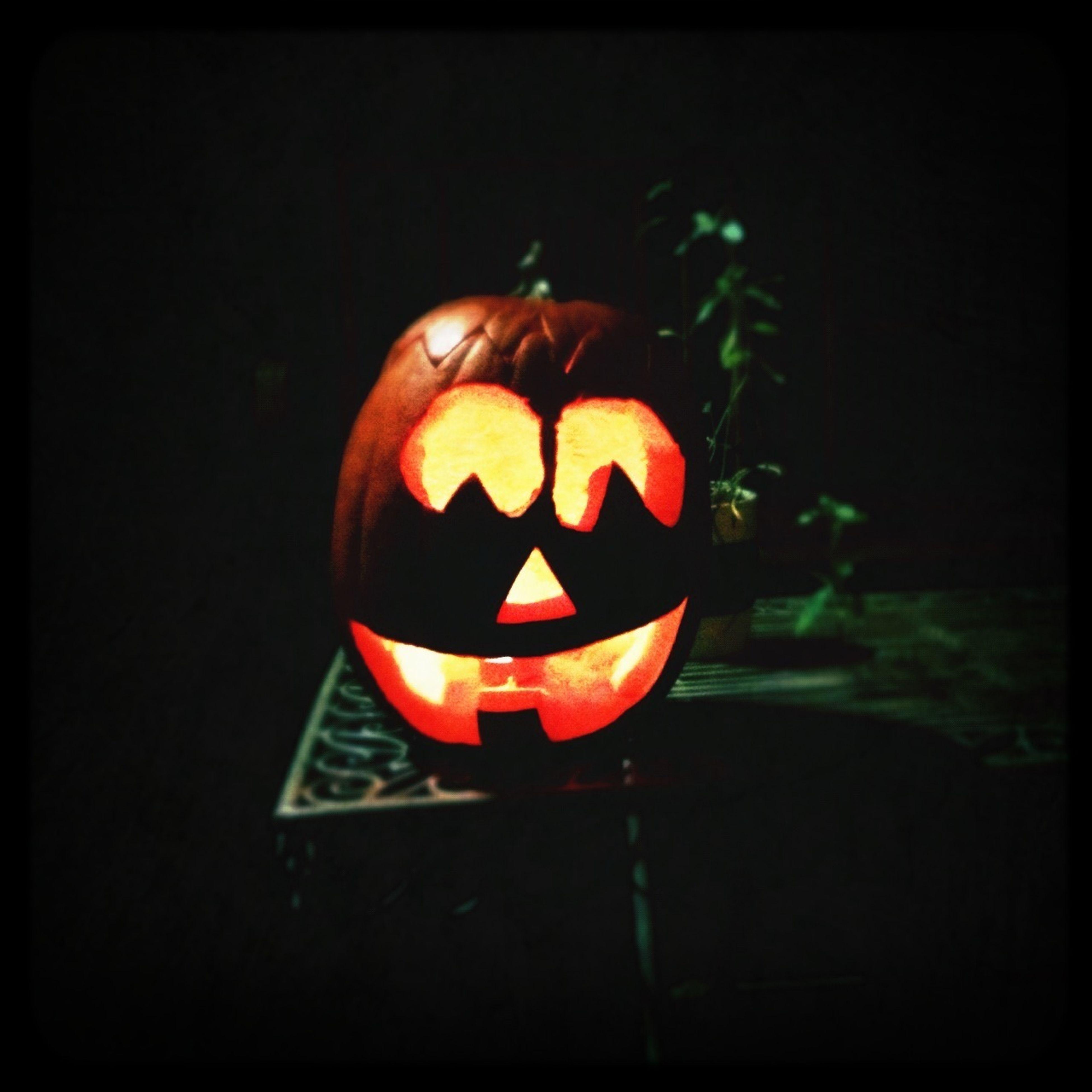indoors, halloween, close-up, black background, red, flame, still life, celebration, illuminated, single object, anthropomorphic face, dark, pumpkin, art and craft, studio shot, human representation, burning, night, candle, creativity