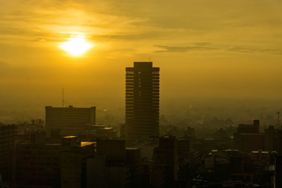 Cityscape of downtown Bogota, Colombia as the sun sets in late afternoon America Architecture Bogotá Building Candelaria Capital City Cityscape Colombia Colonial Colors Cundinamarca Downtown Façade Historic House Landmark Outdoors South Street Sunset Traditional Travel Urban View