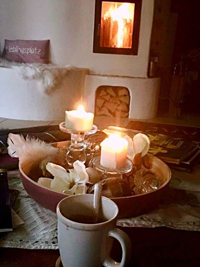 Cozy fireplace burning candels ans a hot Cup with your favourite drink - the perfect Winter Dream Fireplace Cozy Place Winter Time Candle Flame Indoors  Heat - Temperature Burning Glowing No People Illuminated Home Interior
