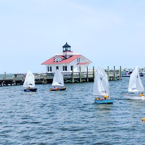 Children learning to Sail - Manteo, NC Outdoors Sailing Boat On Lake Sailboat Masts Children North Carolina Outer Banks, NC Waterfront Small Town Summertime