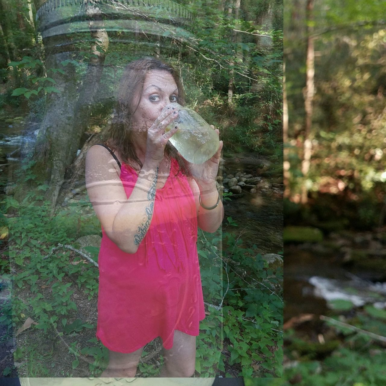 drinking, one person, refreshment, holding, outdoors, day, young adult, grass, standing, water, drink, young women, forest, real people, tree, one young woman only, nature, blond hair, freshness, people, adult, adults only