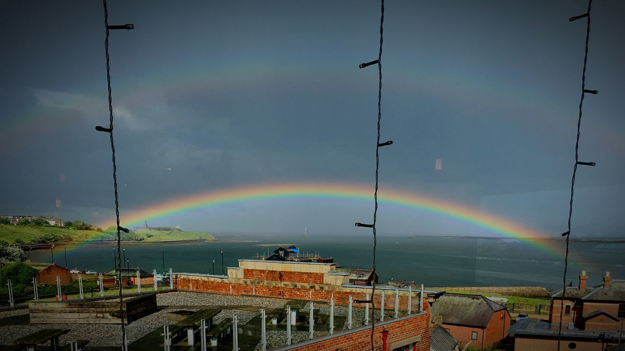rainbow, double rainbow, multi colored, sky, built structure, architecture, beauty in nature, nature, cloud - sky, building exterior, no people, scenics, water, outdoors, day, sea