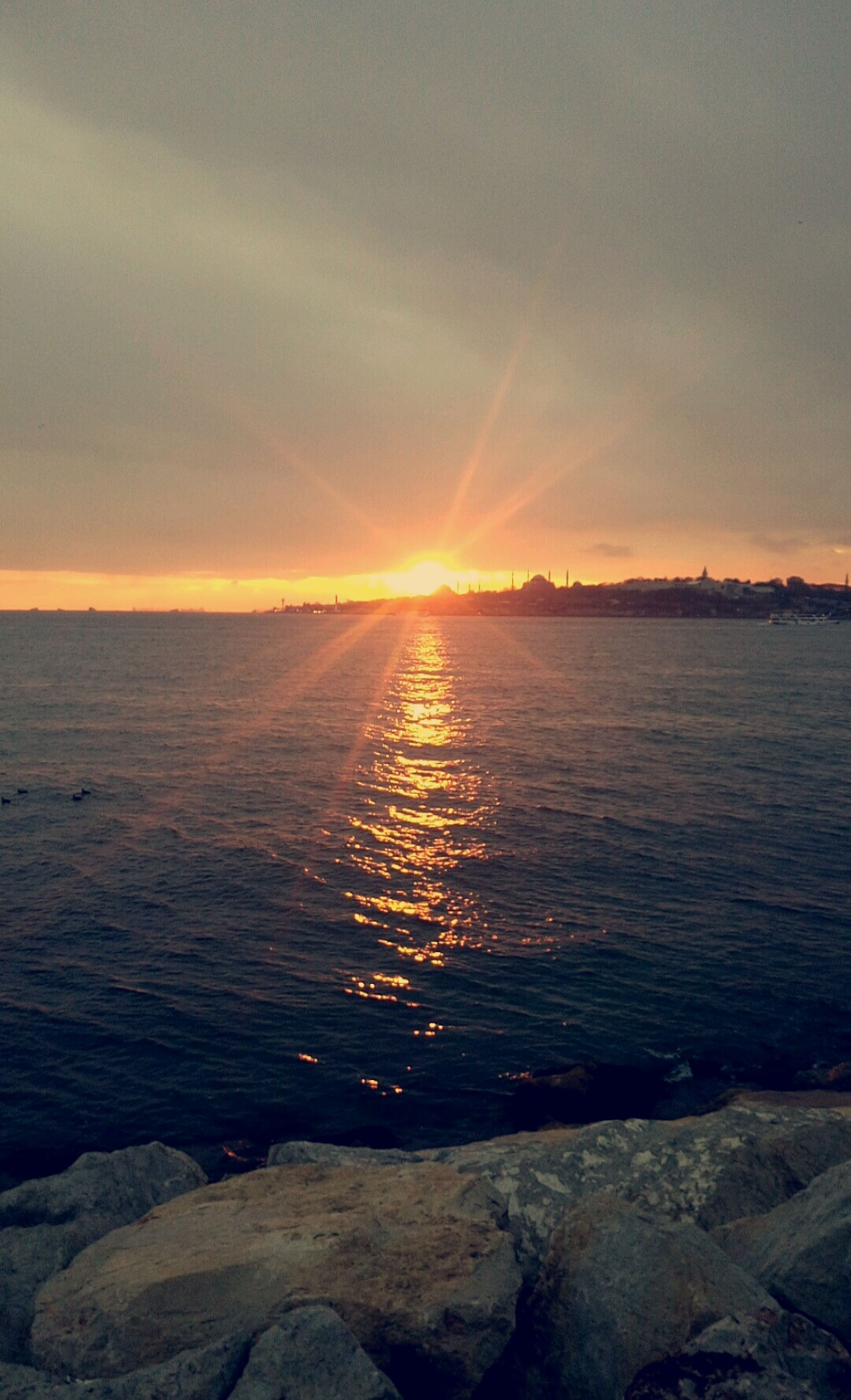 sunset, sea, beauty in nature, scenics, nature, outdoors, tranquil scene, horizon over water, no people, wave, sky, tranquility, beach, water, day