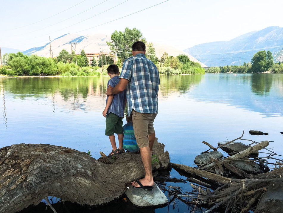 Beauty In Nature Casual Clothing Father And Sons Full Length Leisure Activity Lifestyles Nature Rear View River Water Feel The Journey