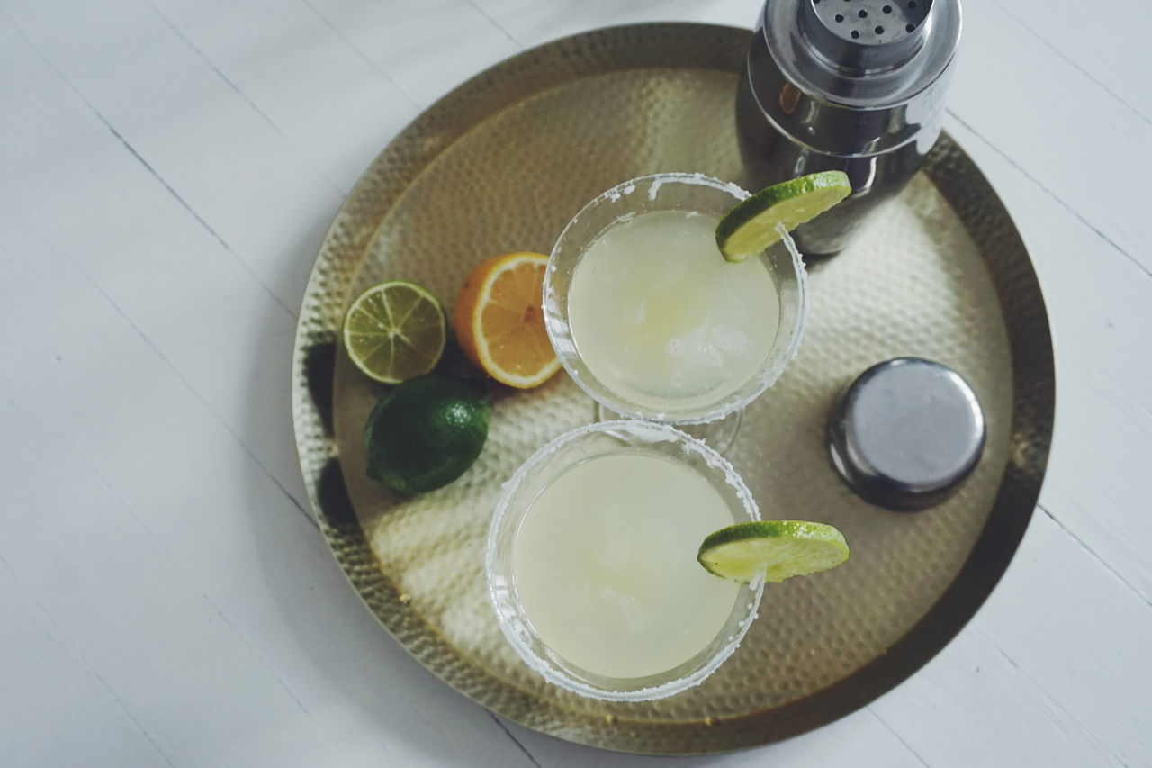 Two Margaritas on a brass tray Citrus Fruit Cocktail Cocktail Time Cocktails Day Drink Drinking Drinking Glass Drinks Food Food And Drink Freshness Healthy Eating High Angle View Indoors  Margarita Margaritas No People Shaker Table