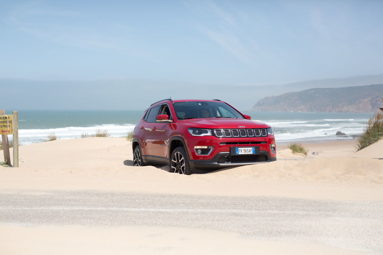 Jeep Compass Jeep Compass Portugal Sand Beach Sea Desert Sand Dune Transportation Water Red Sky Horizon Over Water Outdoors Day Car Heat - Temperature Landscape Nature Vacations Adult Adventure Clear Sky