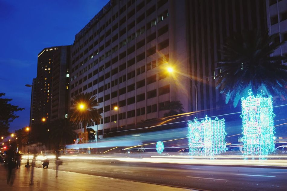 Finding New Frontiers Illuminated Night City Christmas Lights Street Light Long Exposure Cold Temperature Motion Business Finance And Industry No People Sky Tree Winter Vehicle Light Transportation Outdoors Architecture Building Ayala Phillipines EyeEm Phillipines