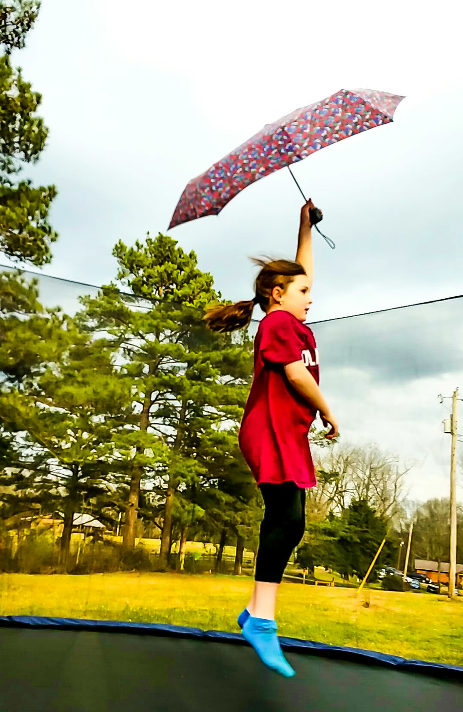 Full Length One Person Lifestyles Activity Tree Sport Jumping People Outdoors Wellbeing Motion Only Women One Woman Only Adults Only Taking A Shot - Sport Sky Day Trampoline Umbrella Learning To Fly Floating On Air Childhood Funny Moment Outdoor Activity Funny Kid