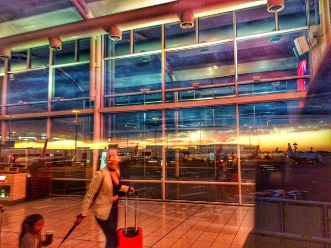 Early morning arrival Never Stop Travelling Sydney Airport Travelling Sunrise Daybreak Reflections Airport Window Real People Indoors  Architecture
