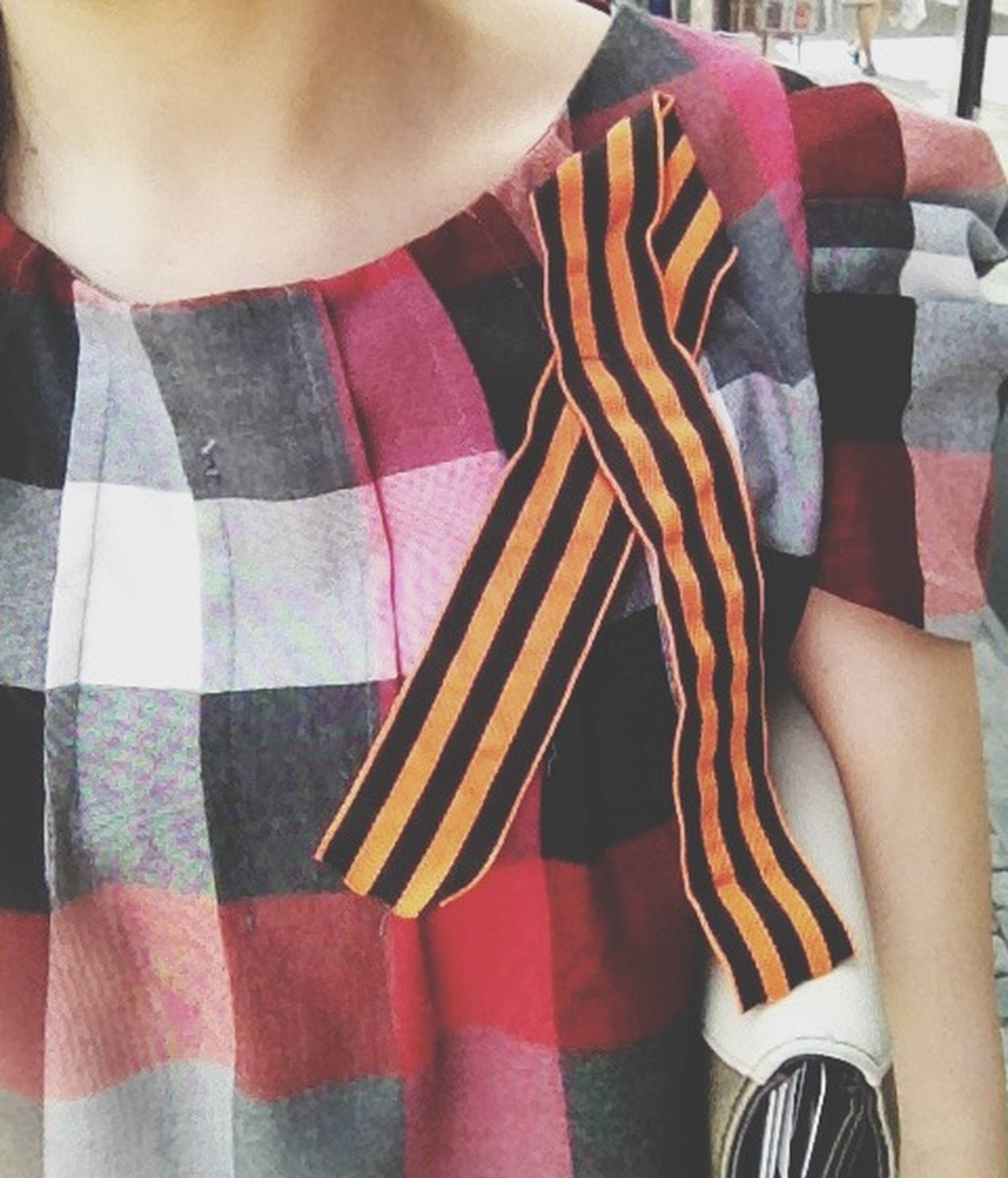 low section, person, striped, fashion, red, indoors, standing, lifestyles, midsection, multi colored, clothing, casual clothing, close-up, textile, leisure activity, pattern