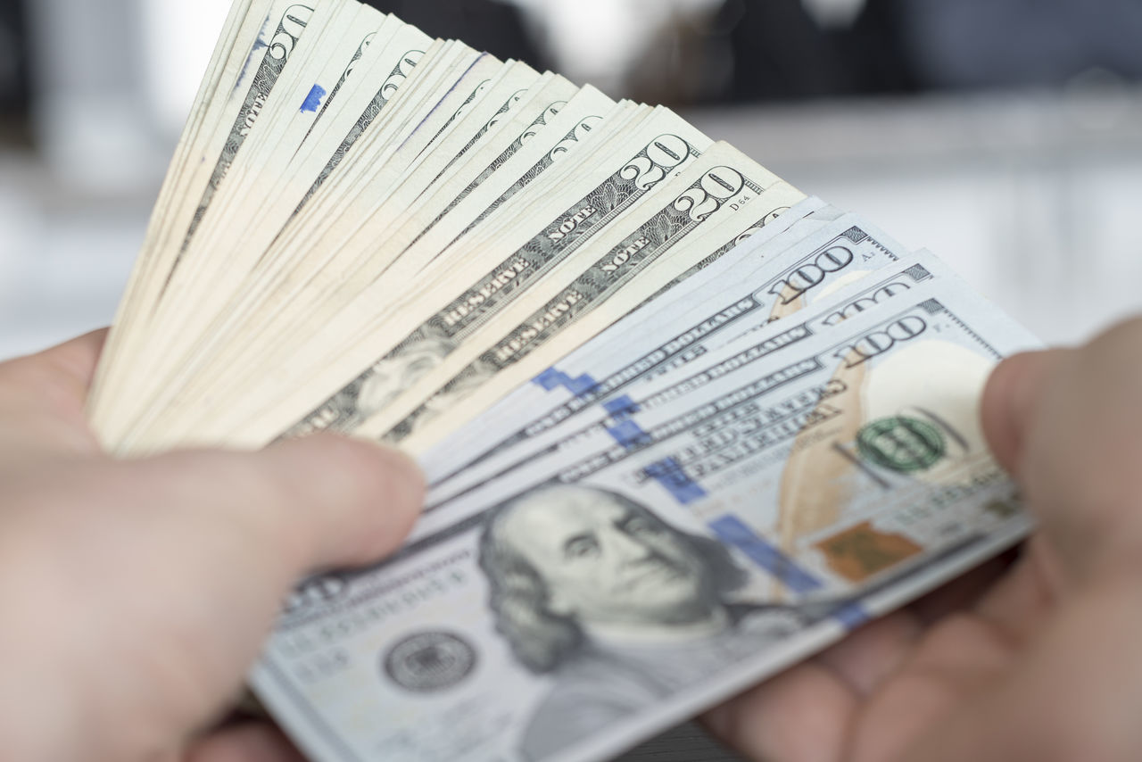 Close up large amount of American money fanned in hands. Accounting American Banking Cash Close-up Counting Currency Finance Financial Item Global Human Body Part Human Hand Investing Investing Market Money Paper Currency Personal Perspective Spending Wealth