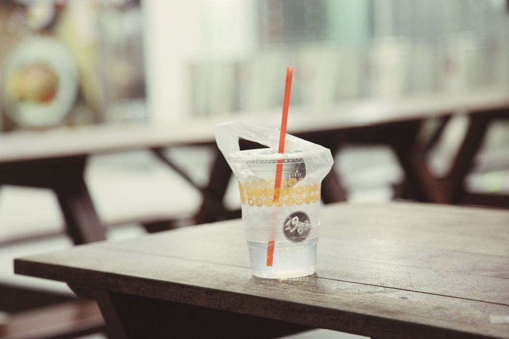 EyeEm Selects Night Drink Drinking Straw Table Food And Drink Drinking Glass Focus On Foreground Refreshment No People Close-up Wood - Material Freshness Icetea Icelemon Icelemonade Icelemontea Plastic Bag Plastic Empty Places Urban EyeEmNewHere