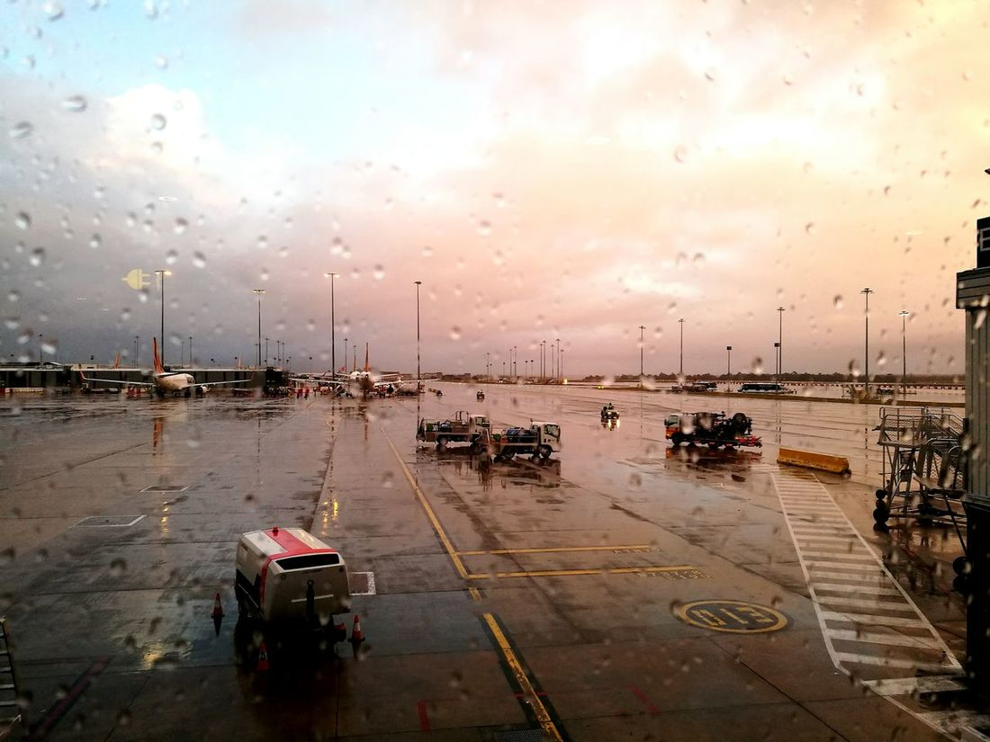 EyeEm Selects Travel Sunset Airport Sky Travel Destinations Outdoors Day Water Adult People Through Glass