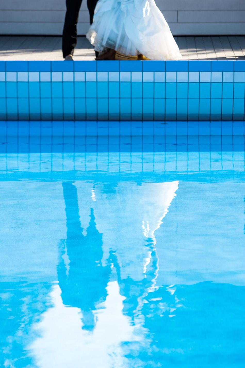 Bride and groom standing on the side of a swimming pool Swimming Pool Low Section Water Reflection Human Leg One Person Blue Day Human Body Part Leisure Activity Outdoors Vacations Real People One Man Only Sky Adults Only People Adult Wedding Bridal Bride Groom