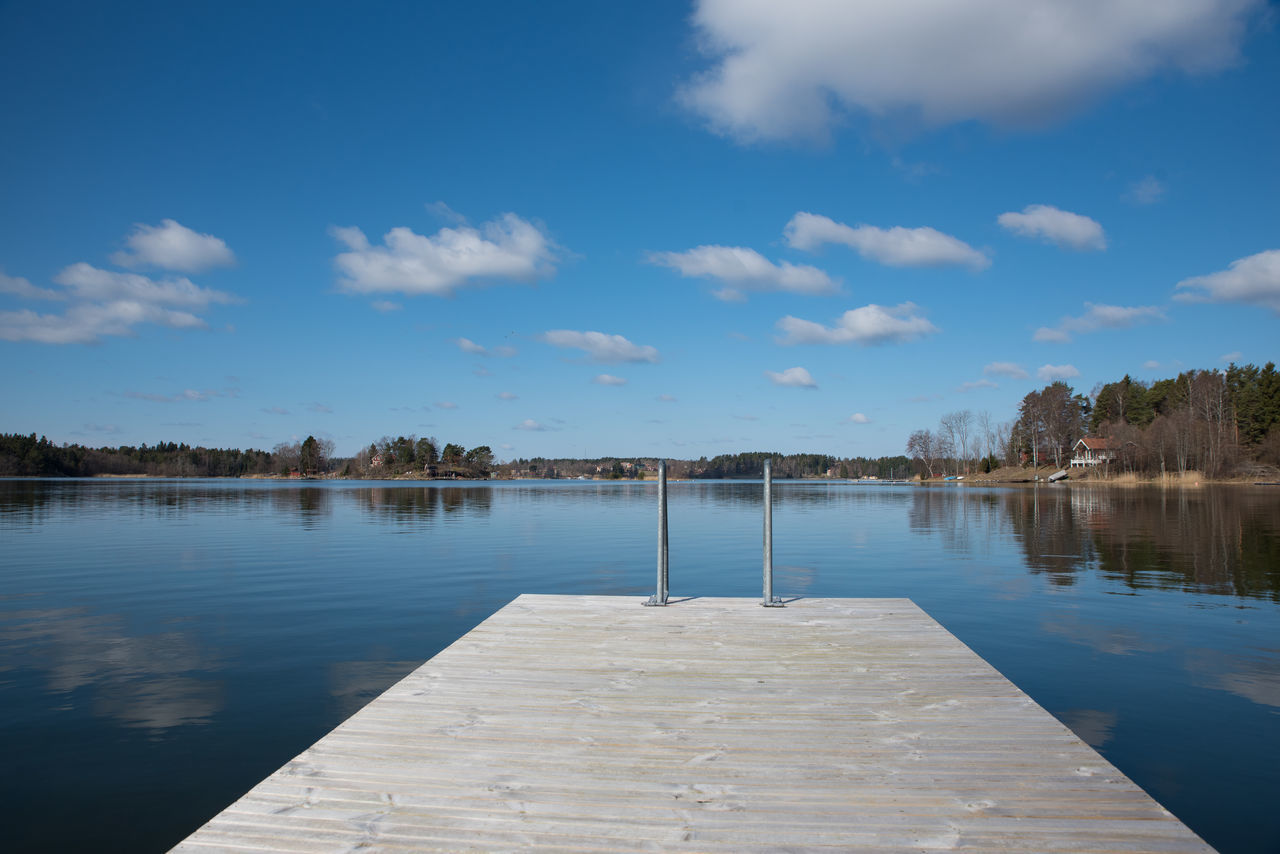 A peaceful dock, blue sky, calm water, sunny day. Beauty In Nature Cloud - Sky Day Lake Nature No People Outdoors Scenics Sky Tranquil Scene Tranquility Tree Water