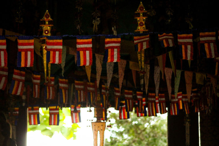 Inside A Buddhist Temple Flaglets In A Temple Monk Prayer Room Light And Shadows Hanging Asian Culture Travel Photography Siem Reap, Cambodia Travel Articles Of Religion No People Outdoors Religion Travel Destinations Sky