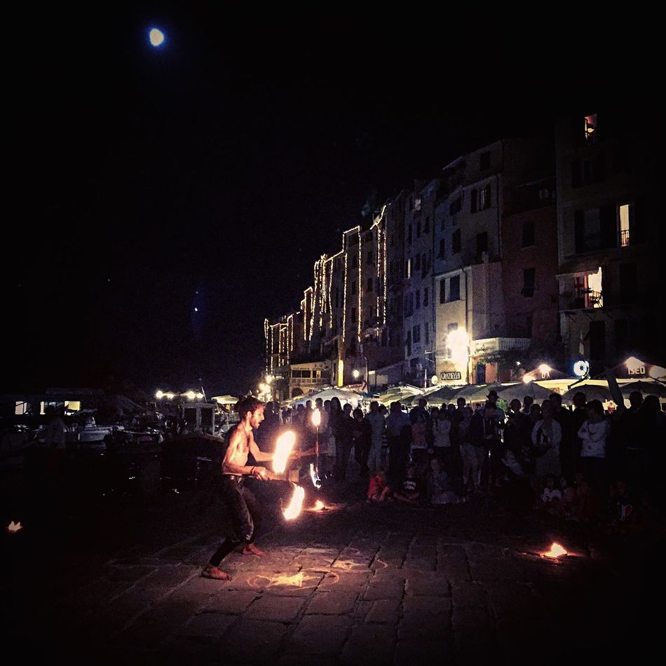 Night Building Exterior Street Illuminated Outdoors Real People Celebration Architecture Sky Crowd People One Man Only Fire Fire Dancer Italy Italia Street Entertainment Street Entertainer Portovenere Moon Village Coast Fire Juggler Welcome To Black Art Is Everywhere