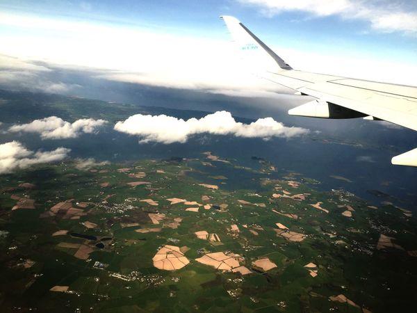 Flight ards peninsula Ireland fields wing airplane flying