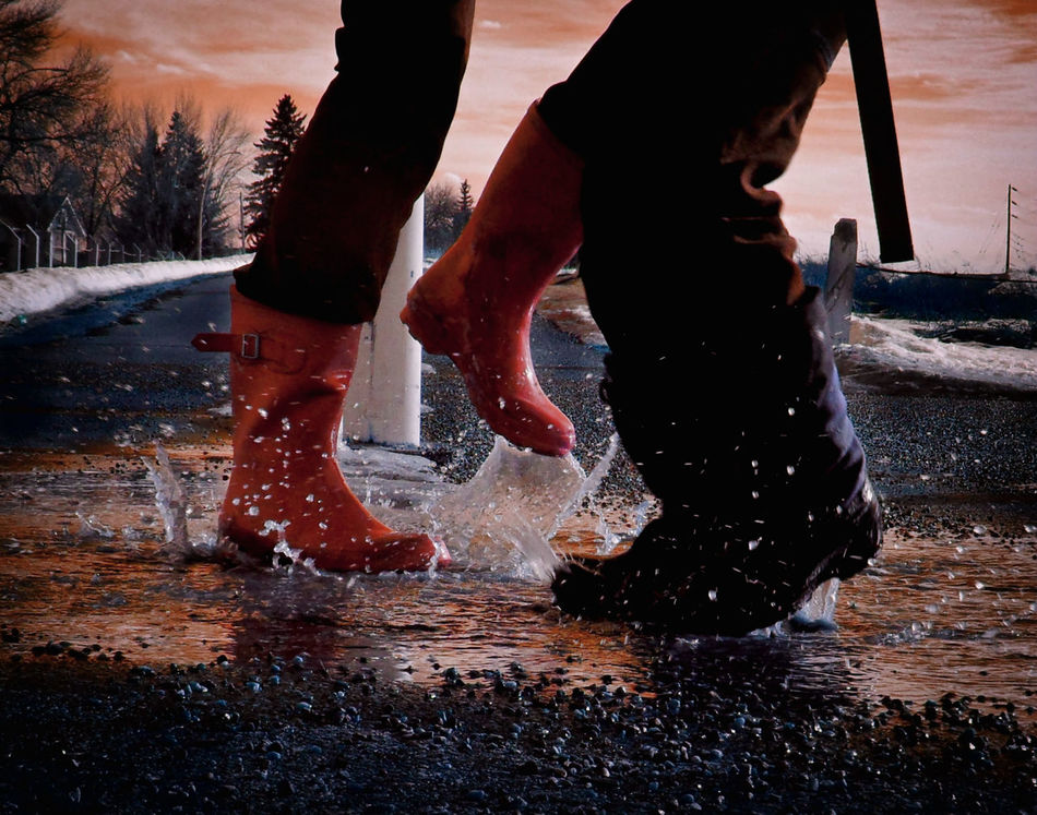 Puddles; an opportunity, not an obstacle :D Happy Thursday! Boots Carefree Chinook Weather Fun Low Section Motion Orange Sky Outdoors People Puddle Jumping Puddles Reflection Rubber Boots Snow Splashing Sunset Two People Water Wet Winter
