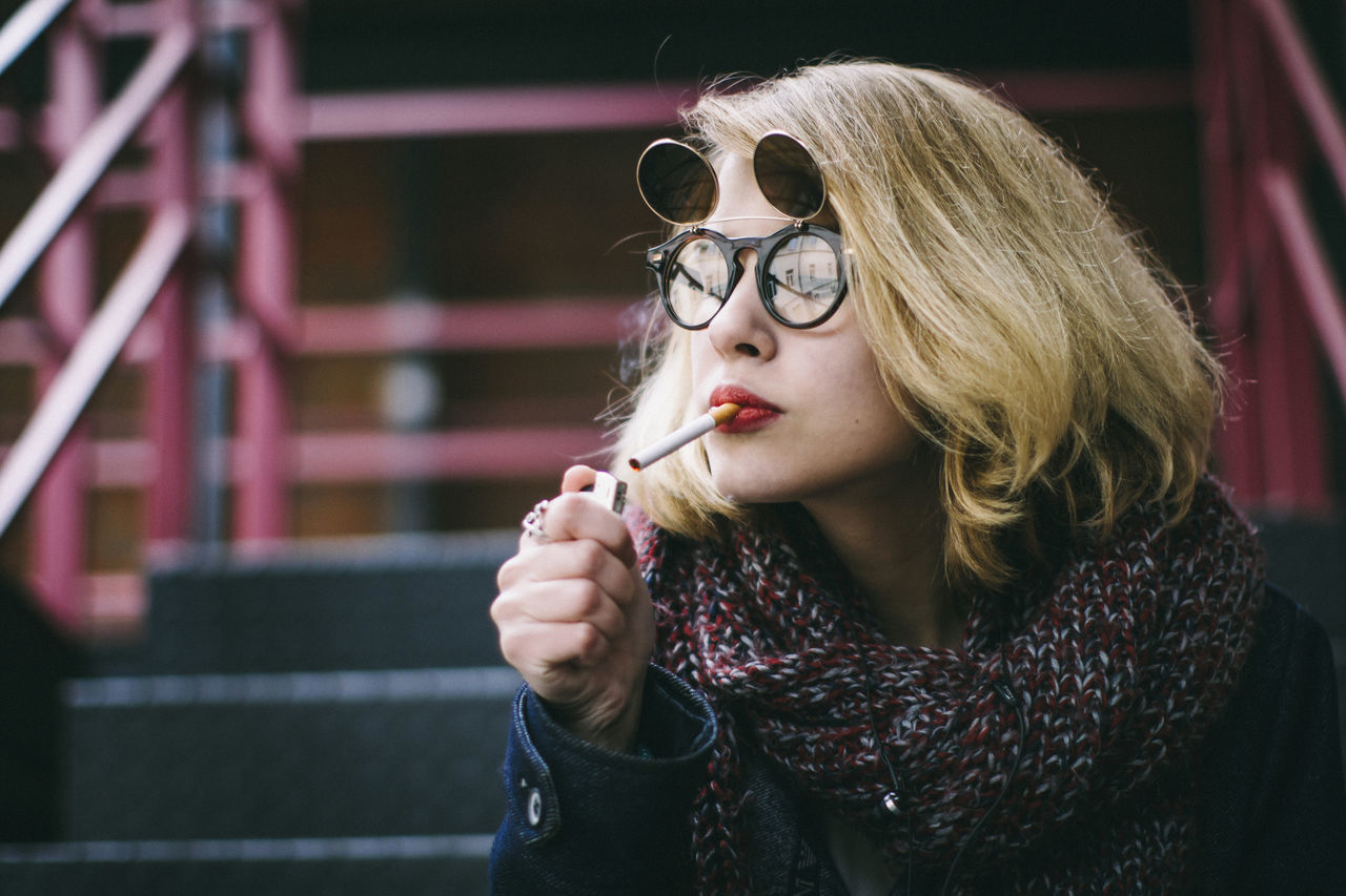 Beautiful stock photos of cigarette, 18-19 Years, Addiction, Bad Habit, Blond Hair