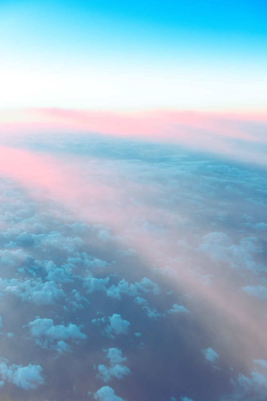 beauty in nature, nature, scenics, sky, cloud - sky, tranquility, majestic, atmospheric mood, outdoors, no people, blue, tranquil scene, vibrant color, sea, ethereal, sunset, sky only, the natural world, aerial view, day, water, backgrounds