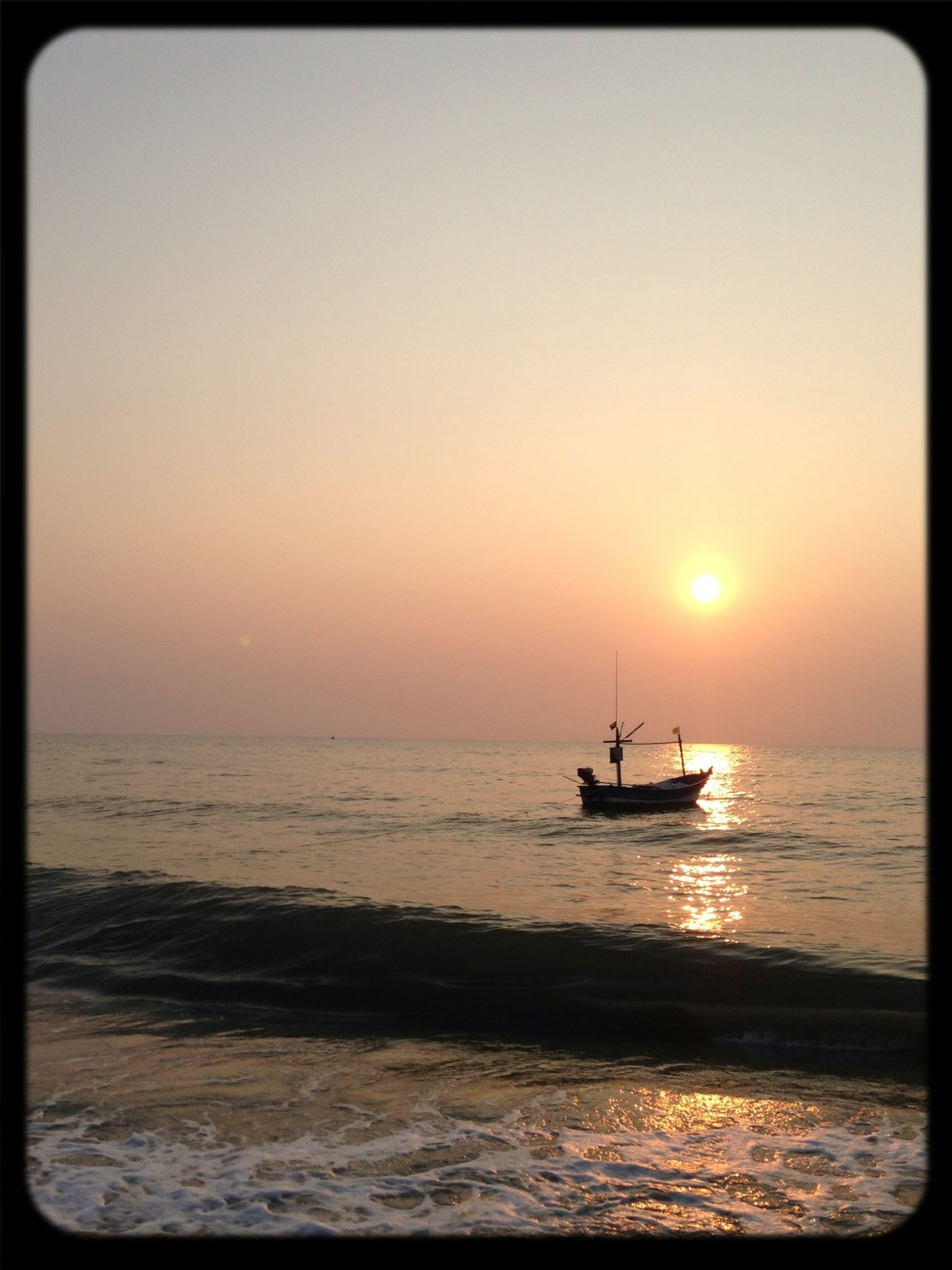 sea, sunset, water, horizon over water, nautical vessel, transportation, boat, scenics, mode of transport, tranquil scene, beauty in nature, tranquility, sun, orange color, nature, sky, silhouette, idyllic, auto post production filter, transfer print