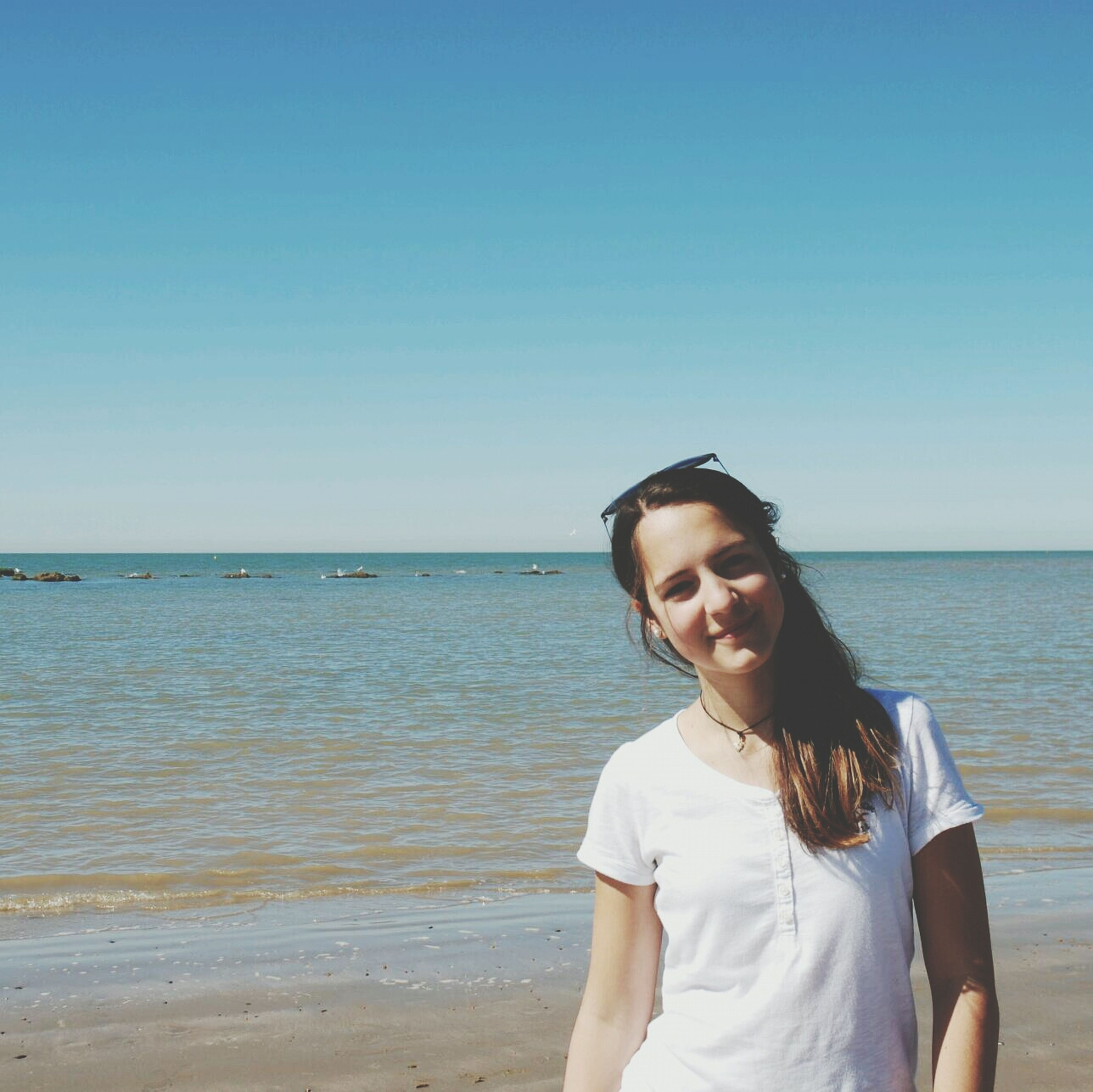 sea, water, clear sky, beach, horizon over water, copy space, young adult, lifestyles, leisure activity, shore, person, vacations, blue, beauty in nature, tranquility, scenics, nature, young women