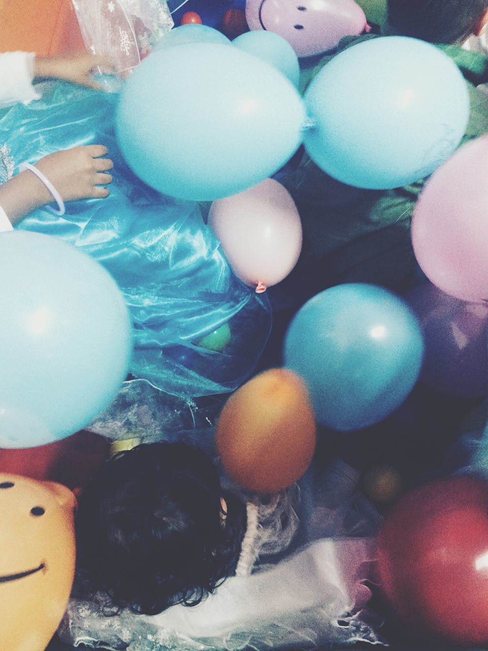 celebration, multi colored, egg, indoors, balloon, human body part, real people, one person, easter, food, large group of objects, human hand, day, close-up, people