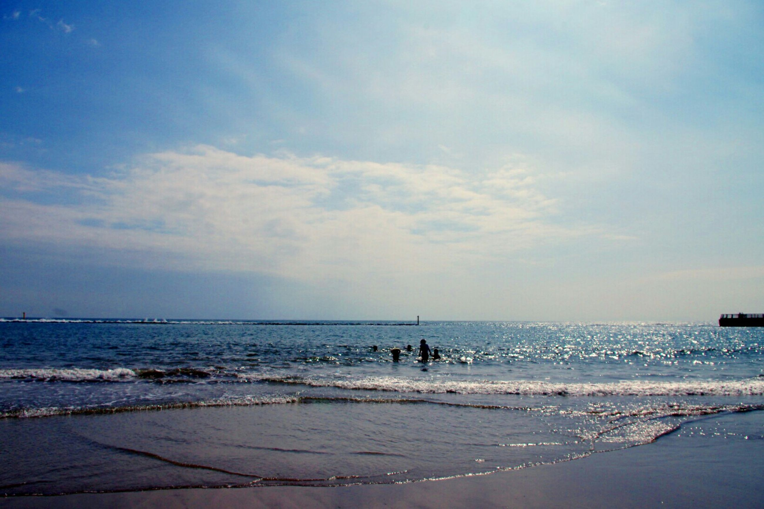 sea, horizon over water, water, beach, sky, scenics, shore, tranquil scene, tranquility, beauty in nature, cloud - sky, silhouette, nature, incidental people, idyllic, cloud, wave, sand, outdoors