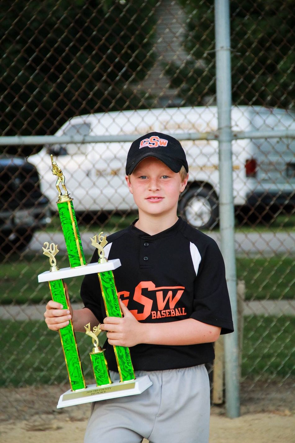 My son with the team trophy for 1st place in their league. So proud of these kiddos! Childhood Innocence Boy Baseball Trophy Portrait