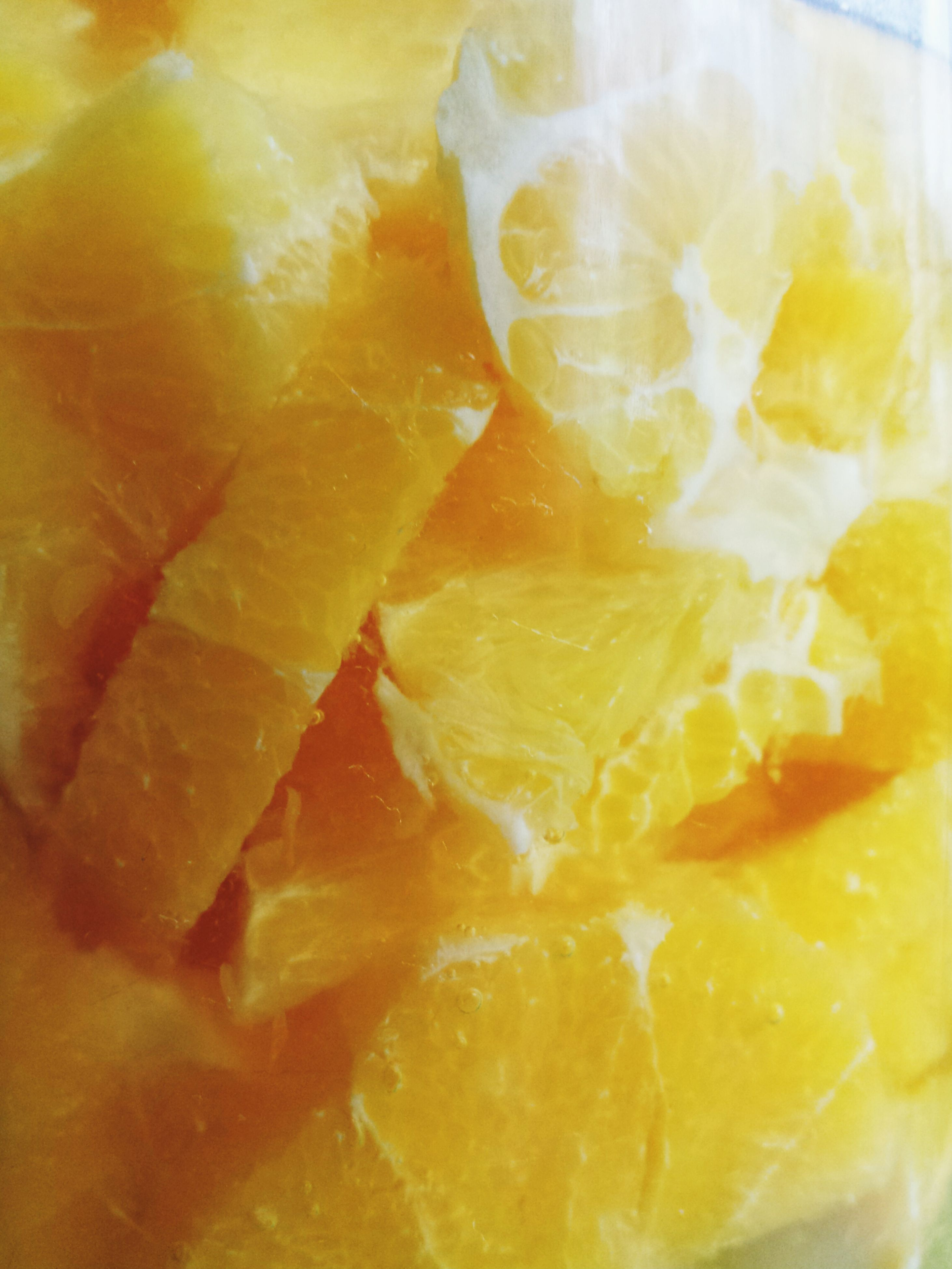 food and drink, food, freshness, indoors, close-up, sweet food, still life, indulgence, ready-to-eat, unhealthy eating, yellow, dessert, full frame, slice, temptation, backgrounds, no people, fruit, high angle view