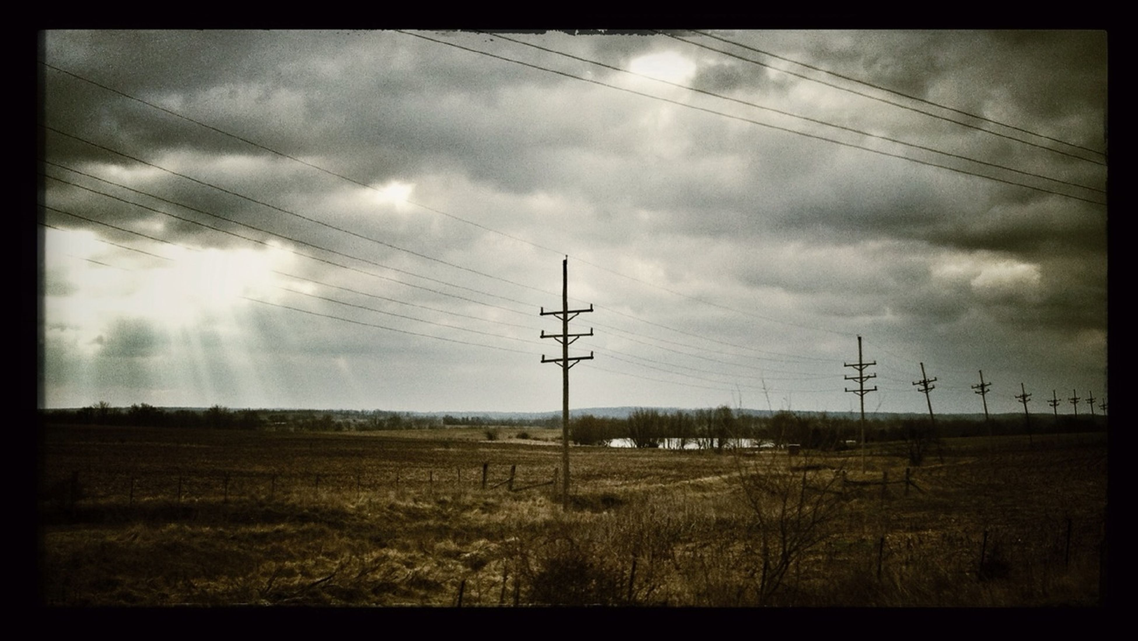 power line, electricity pylon, power supply, fuel and power generation, electricity, sky, field, landscape, cloud - sky, rural scene, cable, technology, tranquil scene, tranquility, connection, cloud, nature, cloudy, transfer print, scenics
