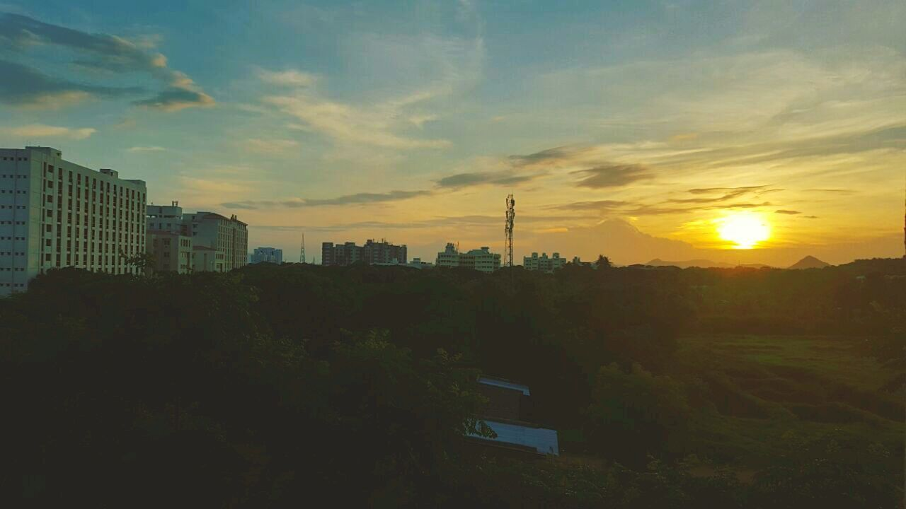 sunset, architecture, sky, building exterior, built structure, no people, city, skyscraper, growth, outdoors, cityscape, tree, nature, beauty in nature, day